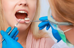 Dentist at work on woman patient in office Royalty Free Stock Images