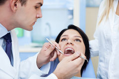 Dentist at work. Dentist working with patient Royalty Free Stock Image