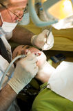 Dentist working Stock Photography