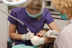 Dentist working stock photo