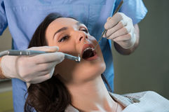 Dentist working on patient Royalty Free Stock Image