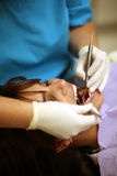 Dentist working on patients mouth Royalty Free Stock Photography