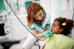 Dentist on working place in dental practice with patient Royalty Free Stock Photography