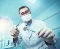 Dentist while working Royalty Free Stock Image