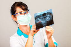 Dentist with xray Stock Photography