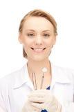 Dentista con gli strumenti Fotografia Stock