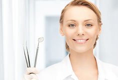 Dentista con las herramientas Foto de archivo