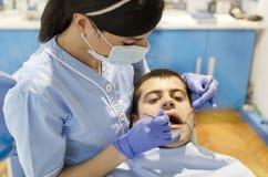 Dentista da mulher Foto de Stock
