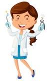 Dentista de sexo femenino con el equipo Foto de archivo