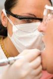 Dentista en el trabajo Fotos de archivo libres de regalías