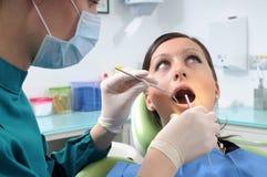 Dentista y chequeo foto de archivo