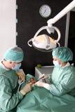 Dentiste au travail Images libres de droits