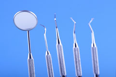 Dentistic tools on blue bacground Stock Images