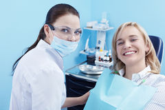 In dentistry. The patient on examination by a doctor in a dental clinic Royalty Free Stock Photos