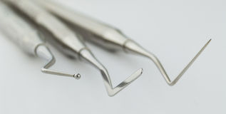 Dentistry. Sets of dental instruments and tools on neutral background Stock Photos