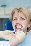 Dentistry. Medical treatment at the dentist office royalty free stock image