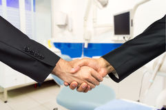 Dentistry agreement. Partners in agreement in the odontology business Royalty Free Stock Photo