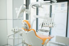 Dentistry clinics. Dentistry armchair and other equipment necessary for dental check-up and treatment Stock Photos