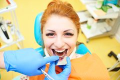 Dentistry, dental treatment. Attractive girl in dental chair at the reception of dentists. Dentistry, teeth whitening, dental fillings, smile, tooth decay stock images