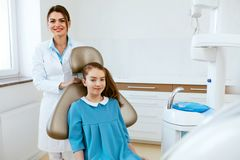 Dentistry. Dentist Doctor And Patient In Clinic. Dentistry. Female Dentist Doctor And Little Patient In Light Dental Clinic. High Resolution royalty free stock photo