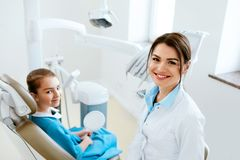 Dentistry. Dentist Doctor And Patient In Clinic. Dentistry. Female Dentist Doctor And Little Patient In Light Dental Clinic. High Resolution stock image