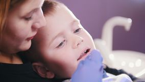 Dentistry. Dentist examines the oral cavity of the kid.