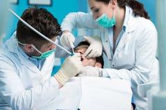Dentistry education. Male dentist doctor teacher explaining treatment procedure. Royalty Free Stock Photo