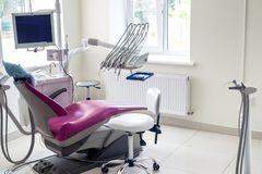 Dentistry inside, violet chair for patient and equipment royalty free stock photos