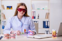 The dentistry student practicing skills in classroom. Dentistry student practicing skills in classroom royalty free stock images