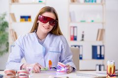 The dentistry student practicing skills in classroom. Dentistry student practicing skills in classroom royalty free stock photos