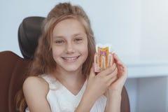 Beautiful young girl visiting dentist stock photos