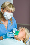 Dentistry, tooth cavity stopping. Dentistry, doctor and patient, tooth cavity filling Royalty Free Stock Image