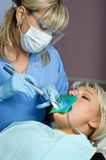 Dentistry, tooth cavity stopping. Dentistry, tooth cavity filling using special polymer with ultraviolet hardening Stock Image