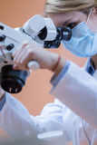 Dentistry using dental microscope Stock Photo