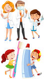 Dentists and children with toothbrush Royalty Free Stock Image