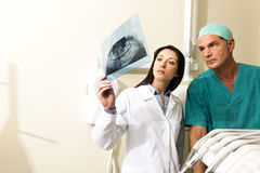 Dentists Consulting. Two Dentists examining x-ray, close-up Stock Photos