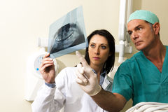 Dentists Consulting. Two Dentists examining x-ray Stock Photos