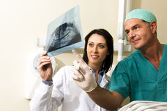 Dentists Consulting. Two Dentists examining x-ray, close-up Royalty Free Stock Photos