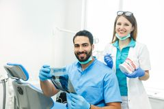 Dentists Discuss Particular Case Royalty Free Stock Photos