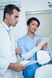 Dentists discussing reports Stock Photo