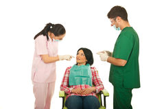 Dentists explain to patient Stock Images