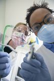 Dentists Holding Dentistry Tools Stock Photos