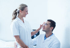 Dentists looking at each other Stock Image