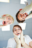 Dentists looking shocked at patient Stock Images