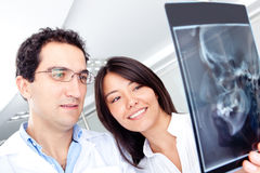 Dentists looking at an x-ray Stock Images