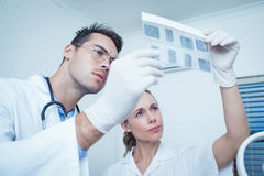 Dentists looking at x-ray Royalty Free Stock Images