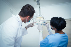 Dentists looking at x-ray Royalty Free Stock Photo