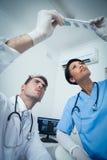 Dentists looking at x-ray Stock Image