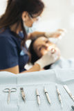 Dentists with a patient during a dental intervention. Royalty Free Stock Photography