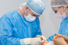 Dentists during surgery Royalty Free Stock Photos